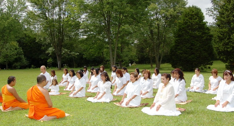 monks and devotees doing Vipassana meditation